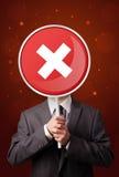 Businessman holding x sign Stock Image