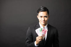 Businessman holding yuan money in his hands Stock Photos