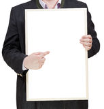 Businessman holds blank billboard in hands Royalty Free Stock Photography