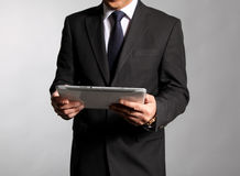 Businessman holds a  booklet Royalty Free Stock Images