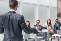 Businessman holds a briefing with the business team stock images