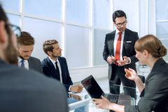Businessman holds a briefing with the business team. Meetings and partnerships royalty free stock images
