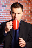 Businessman holds cup of coffee Royalty Free Stock Photo