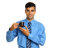 Businessman holds cup of coffee Stock Photography
