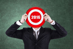 Businessman holds dartboard with numbers 2016 Stock Image