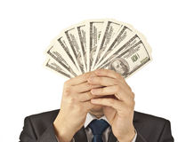 Businessman holds dollars. Fanned closing of its head Royalty Free Stock Photo