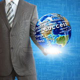 Businessman holds Earth in hand Stock Images