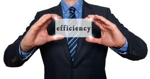 Businessman holds efficiency sing in his hands - White - Stock P Stock Photos