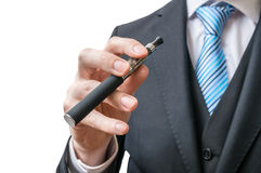 Businessman holds electronic cigarette in hand. Isolated on white Stock Images