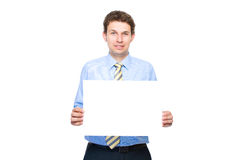 Businessman holds empty, blank card, copyspace Royalty Free Stock Image