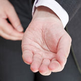 Businessman holds empty handful close up Royalty Free Stock Photography