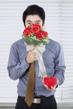 Businessman Holds Flowers and Gift Box Stock Images