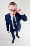 Businessman holds glasses Royalty Free Stock Photos