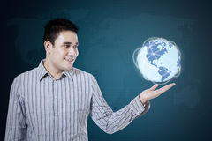 Businessman holds globe earth Stock Images