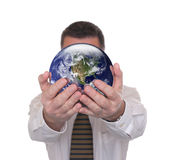 Businessman holds globe featuring America Royalty Free Stock Image
