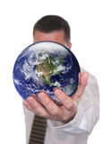 Businessman holds globe featuring America Royalty Free Stock Photography