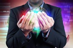 Businessman holds globe Royalty Free Stock Image
