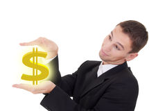Businessman holds golden US dollar sign Stock Image