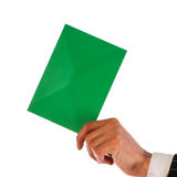 Businessman holds a green envelope Stock Image