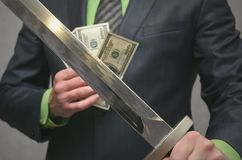 Finance insurance agent. Money deposite safety agent. Businessman holds in hand a toy sword weapon. Finance insurance agent. Money deposite safety agent Stock Images