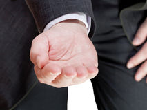 Businessman holds handful - hand gesture Stock Image