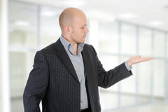 Free Businessman Holds His Hand Palm Up. Stock Image - 14923181