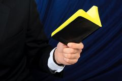 Businessman holds his notebook Stock Photography