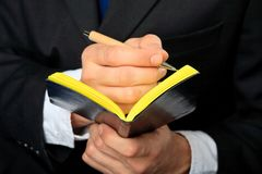 Businessman holds his notebook Royalty Free Stock Image