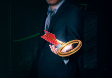 Businessman holds key team business in hand on background. Royalty Free Stock Image