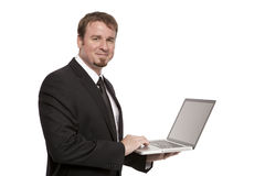 Businessman holds a Laptop Stock Image