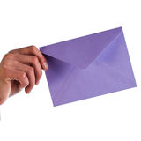 Businessman holds a lilac envelope Royalty Free Stock Photo