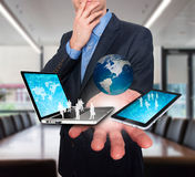 Businessman holds modern technology in hands - Stock Image Stock Photos