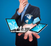 Businessman holds modern technology in hands - Stock Image Royalty Free Stock Image