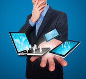 Businessman holds modern technology in hands - Stock Image Royalty Free Stock Photo