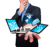 Businessman holds modern technology in hands - Stock Image Royalty Free Stock Photography