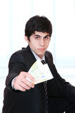 Businessman holds money Royalty Free Stock Images