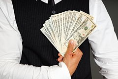 Businessman holds money Stock Photos