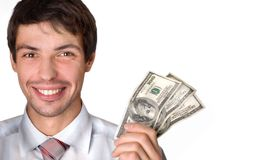Businessman holds money in a hand. The businessman in a white shirt. The man shows money. Dollars are developed by a fan Stock Photos