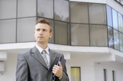 Businessman holds the notebook. On the building background Royalty Free Stock Images