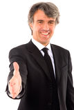 Businessman holds out his hand Royalty Free Stock Photography