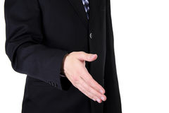 Businessman Holds out his Hand for a Handshake Royalty Free Stock Photo