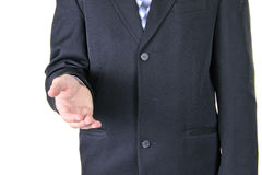 Businessman Holds out his Hand for a Handshake Stock Images
