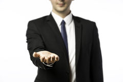 Businessman holds out his hand Royalty Free Stock Images