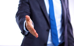 Businessman holds out his hand to greet Royalty Free Stock Image