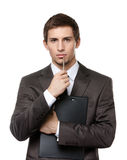 Businessman holds paper folder and pen Stock Image