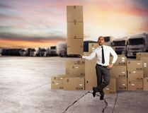 Businessman holds a pile of packages in a hand. concept of fast delivery stock photo