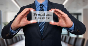 Businessman holds premium service in his hands. Office - Stock Photo royalty free stock photos