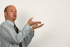 Businessman holds presentation Stock Photos