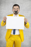 Businessman holds a sheet of paper, a ban on speaking Stock Images