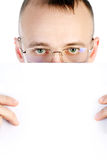 Businessman holds sheet of paper Royalty Free Stock Images